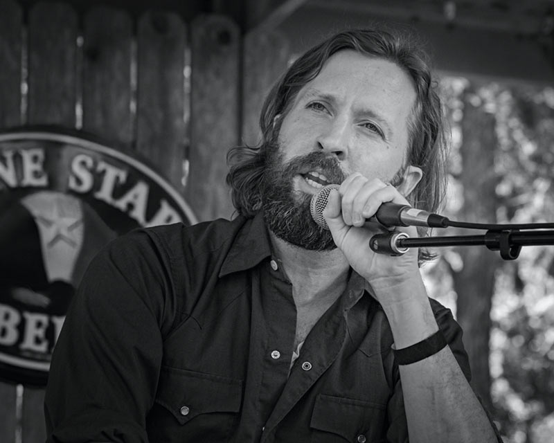 Owen Temple performing in Luckenbach Texas - Image 1