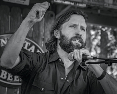 Owen Temple performing in Luckenbach Texas - Image 2